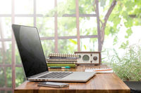 laptop on wooden worktable