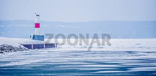 petorskey soast lighthouse on lake michigan in winter