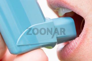 closeup of woman with asthma aerosol