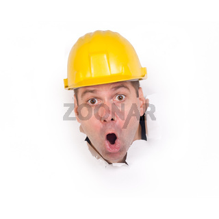 craftsman with his head in the wall