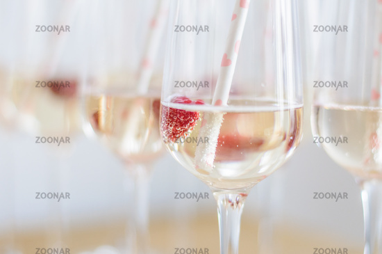 champagne reception with rawsberries and straws