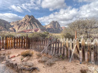 Old rickety wood picket fence in an arid landscape