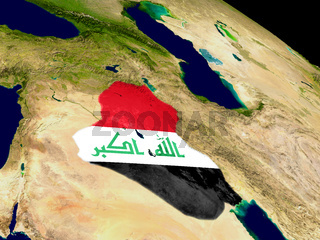 Iraq with flag on Earth