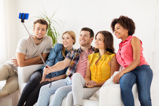 happy friends taking selfie by smartphone at home