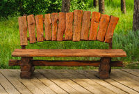 handmade wood bench in a green park