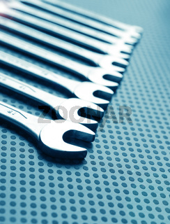 Modern industrial background with wrench assortment