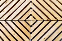 Symmetrical diamond background pattern with wood