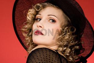 elegant woman is in a hat