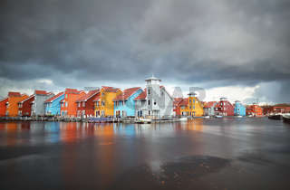 colorful buildings on water during storm