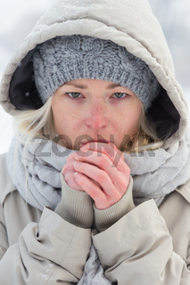 Portrait of lady outdoor in snow in cold winter time.