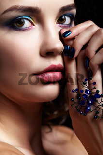 Portrait of beautiful brunette woman on black background