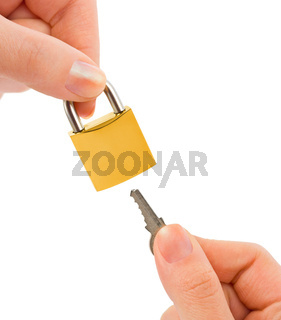 Lock and key in hands