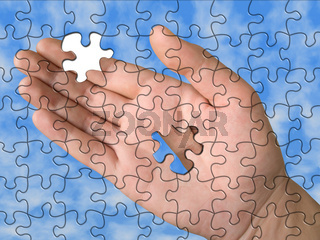 Hand from puzzle without one piece