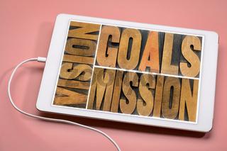 vision, goals, mission concept on tablet