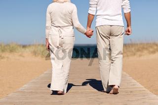 close up of senior couple on summer beach