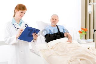 Hospital - doctor examine patient broken arm