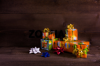Many Christmas presents on planks background