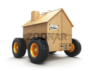 Cardboard house box with wheels isolated on white background. Moving, logistics and delivery concept.