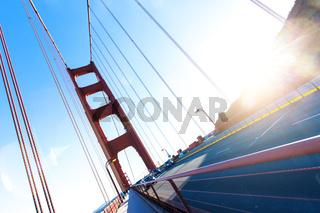 traffic on gold gate bridge with sunbeam