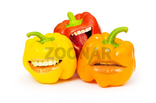 Three bell peppers with funny mouth on white