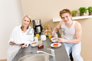 Breakfast happy couple eat cereal drink coffee