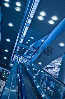 Moving up diagonal escalator in trade center