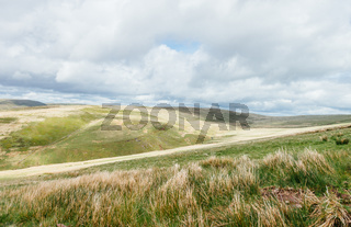Cloudy bright view down to the grassy hills near to Pan Y Fan in Brecon Beacons, Wales