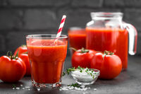 Fresh tomato juice in glass. Vegetable drink