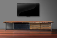 Led tv on gray color wall with wooden table living room