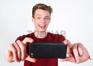 Young man taking selfie