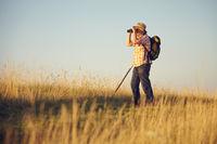 Hikers binoculars meadow sky