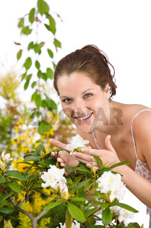 Gardening - Woman with Rhododendron flower blossom
