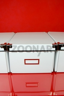 Storage boxes isolated against a red background