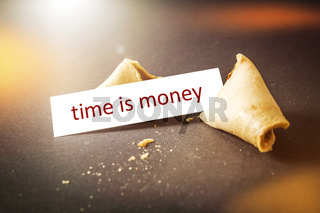 a fortune cookie with message time is money