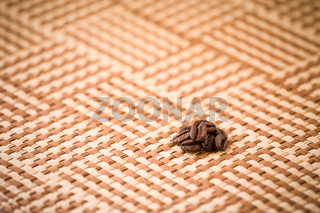 Coffee beans on tablecloth