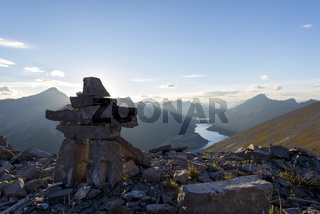 Inukshuk rock sculpture at the summit of a hiking trail