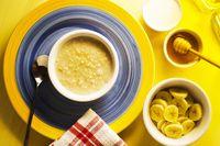 Oatmeal Breakfast with golden shadow. Organic