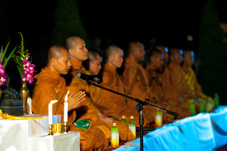 Row Thai Buddhist Monks Outdoor Night Ceremony