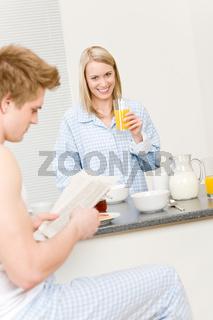 Breakfast happy couple eat cereal drink juice