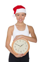 beautiful asian women in a Santa's hat with a clock