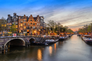 Amsterdam city skyline at canal waterfront when sunset, Amsterdam, Netherlands