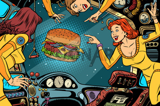 Women astronauts in the cabin of a spaceship and Burger
