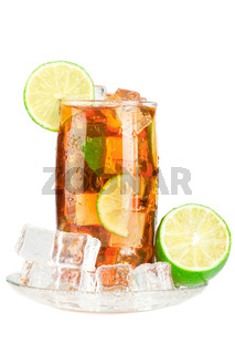 Glass of iced tea with ice cubes, lime and mint