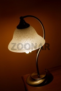 Small lamp glowing in a dark room