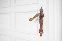 beautiful old door handle - ornate metal door handle