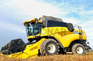 combine harvester during field work on farm