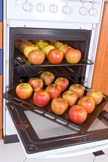 apples on the sheet in the oven