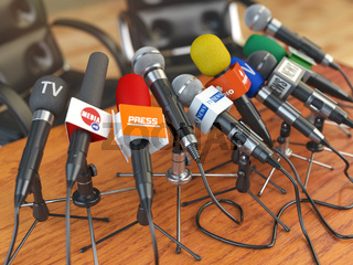 Press conference or interview concept. Microphones of different mass media, radio, tv and press prepared for conference meeting.