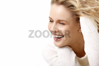 The beautiful smiling girl on a white background
