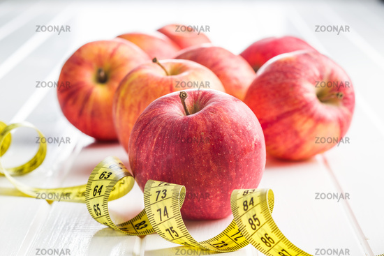 Red apple and measuring tape.